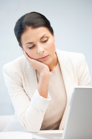 picture of pensive woman with laptop computer  photo