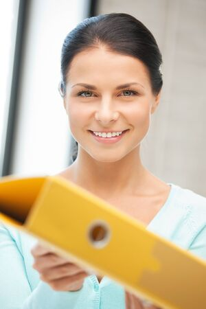 bright picture of beautiful woman with folder photo