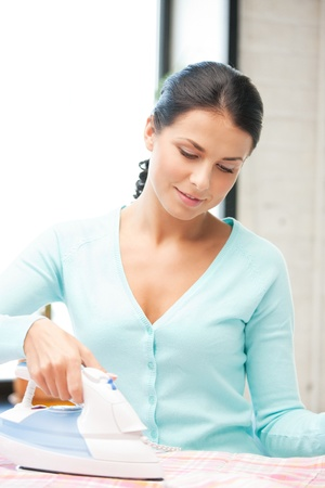 bright housekeeping: bright picture of lovely housewife with iron