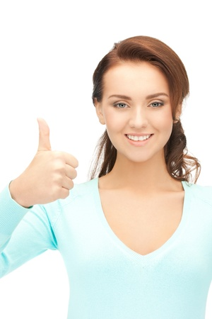 bright picture of lovely teenage girl with thumbs up Stock Photo - 12658671