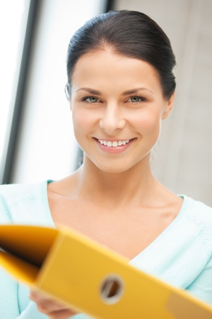 bright picture of beautiful woman with folder Stock Photo - 12683207