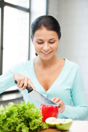nice food: картина красивая женщина в кухне Фото со стока