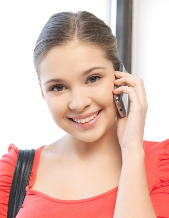 bright picture of woman with cell phone Stock Photo - 12838661