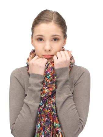 bad feeling: bright picture of sad woman in muffler