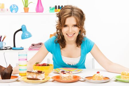 bright picture of lovely housewife at the kitchen sweets Stock Photo - 12838563