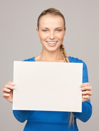bright picture of confident woman with blank board photo