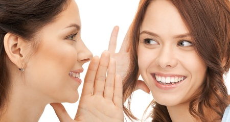 bright picture of two women spreading gossip Stock Photo