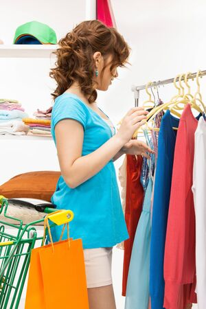 bright picture of lovely woman in shop Stock Photo - 12883740