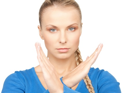 bright picture of young woman making stop gesture Stock Photo - 12883671