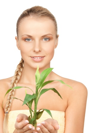 closeup picture of woman with green sprout Stock Photo - 12883820