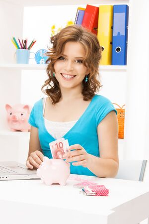 picture of lovely woman with piggy bank and money Stock Photo - 12883841