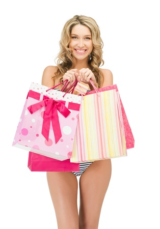 picture of seductive woman in bikini with shopping bags Stock Photo - 12971219