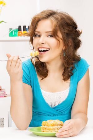 bright picture of lovely housewife at the kitchen sweets Stock Photo - 12971375
