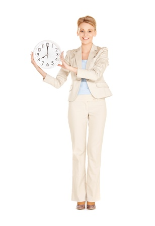 bright picture of woman holding big clock Stock Photo - 12971315
