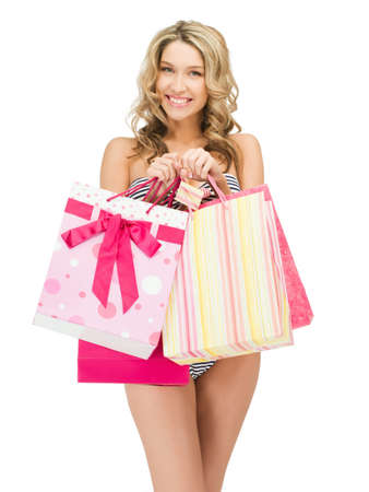 carrying girl: picture of seductive woman in bikini with shopping bags