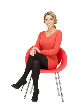 osoba: obraz mladá podnikatelka sedí v křesle Reklamní fotografie