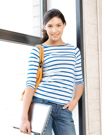 bright picture of happy and smiling teenage girl with laptop Stock Photo - 13042721