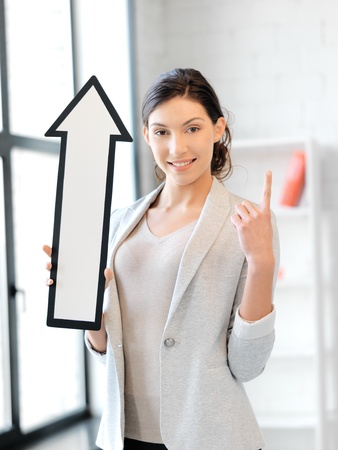 picture of attractive businesswoman with direction arrow sign Stock Photo - 13042706