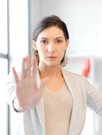 bright picture of young woman making stop gesture Stock Photo - 13042658