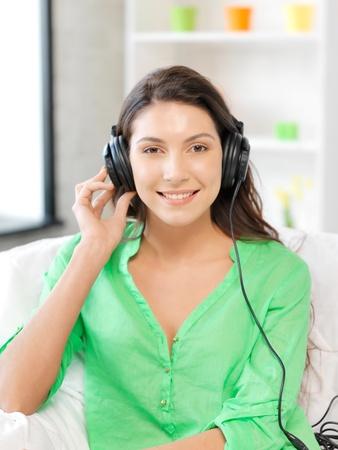 picture of happy teenage girl in big headphones Stock Photo - 13042697