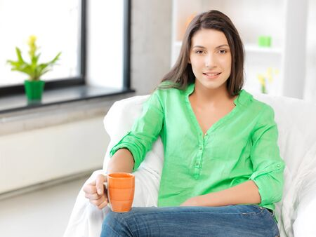 bright picture of lovely woman with mug Stock Photo - 13042735
