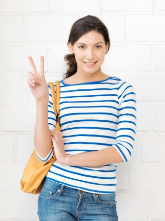 bright picture of lovely teenage girl showing victory sign Stock Photo - 16482568