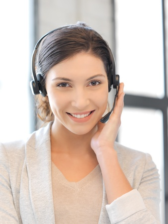 bright picture of friendly female helpline operator Stock Photo - 16482573