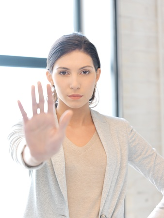 bright picture of young woman making stop gesture Stock Photo - 16464944
