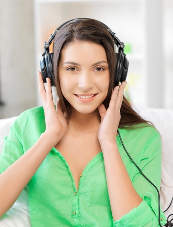 picture of happy teenage girl in big headphones Stock Photo - 16573574