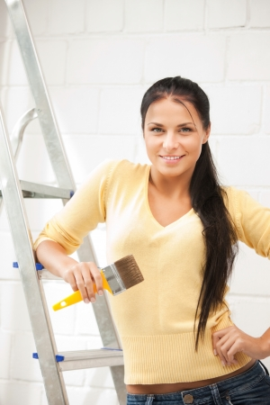 painter girl: bright picture of lovely housewife painting at home Stock Photo