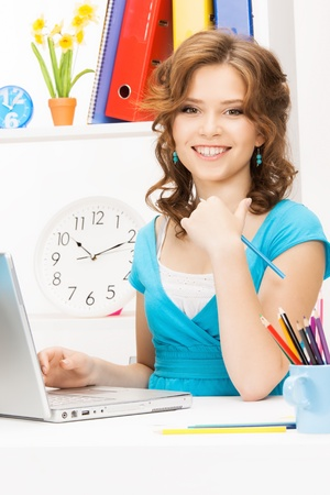 home computer: picture of happy woman with laptop computer Stock Photo
