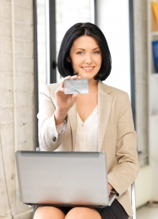 bright picture of happy woman with credit card Stock Photo - 16345638