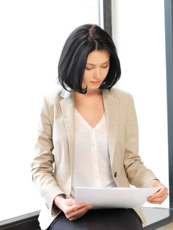 calm woman: bright picture of calm woman with documents