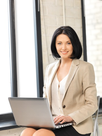 picture of happy woman with laptop computer Stock Photo - 13149484