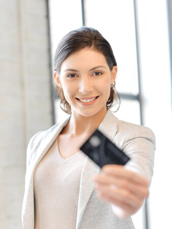 bright picture of happy woman with credit card Stock Photo - 13148781