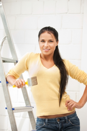 nice house: bright picture of lovely housewife painting at home Stock Photo
