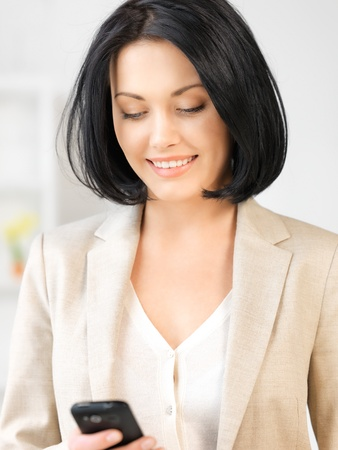 bright picture of businesswoman with cell phone Stock Photo - 13400810