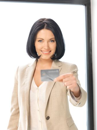 bright picture of happy woman with credit card Stock Photo - 13400765