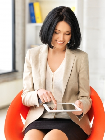 gorgeous businesswoman: picture of happy woman with tablet pc computer