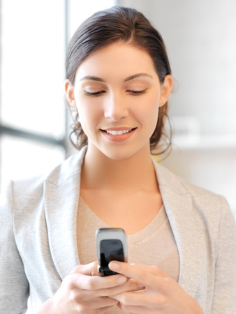 bright picture of businesswoman with cell phone Stock Photo - 13401469