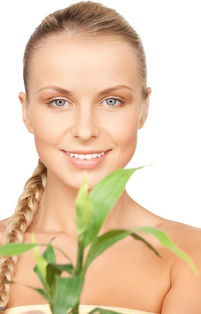 closeup picture of woman with green sprout photo