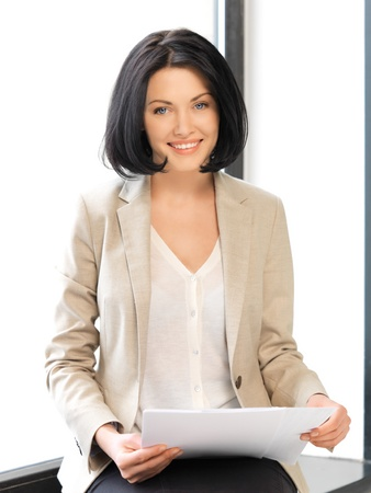 bright picture of happy woman with documents photo