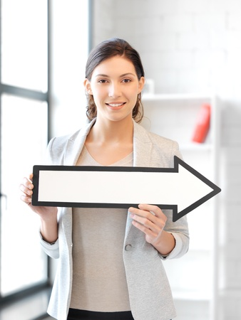 picture of attractive businesswoman with direction arrow sign Stock Photo - 13401036