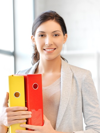 human kind: bright picture of beautiful woman with folder Stock Photo