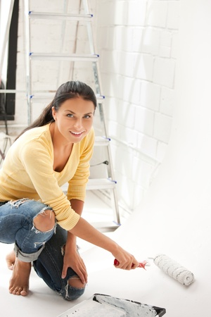 bright picture of lovely housewife painting at home photo