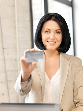 bright picture of happy woman with credit card Stock Photo - 13468489