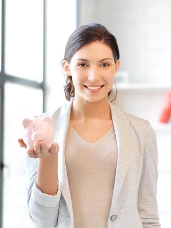 picture of lovely woman with piggy bank Stock Photo - 13468481
