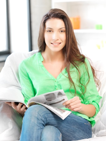 bright picture of happy and smiling woman with magazine