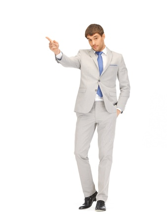 picture of attractive businessman pointing his finger Stock Photo - 13468934