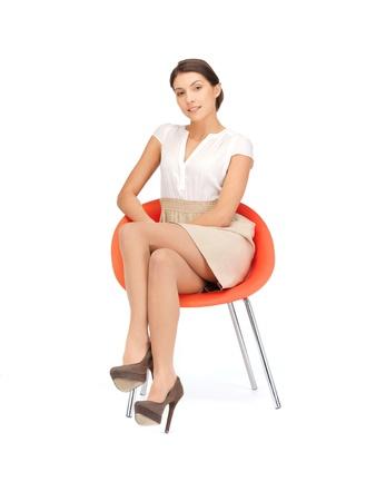 imagen de la joven empresaria sentado en la silla Foto de archivo